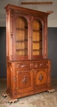 American walnut secretaire bookcase cabinet with arched glass doors in the top, base has a secretaire drawer over two panelled doors, c.1880, 54
