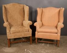 Two companion wing chairs, one is on straight moulded legs with stretcher, 33