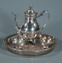 F.B. Rogers silver plated coffee pot with matching cream and sugar along with a companion Towle silver plated tray, 4 pieces