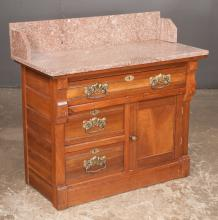 Eastlake mahogany marble top wash stand, base has one long drawer over two half drawers and a panel door, c.1890, 36