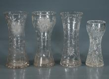 Group of four cut glass vases with etched and cut design, 12