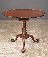 Chippendale style mahogany tip table with scalloped pie crust top,