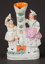 Staffordshire figure with two young girls, one holding a bird, c.1890, 11