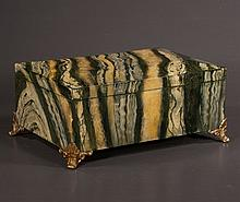 Jewelry chest with marbleised finish and brass feet, by