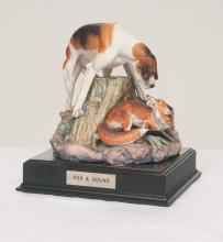 Decorated figure of a fox and hunting hound on a wooden base, 9.5