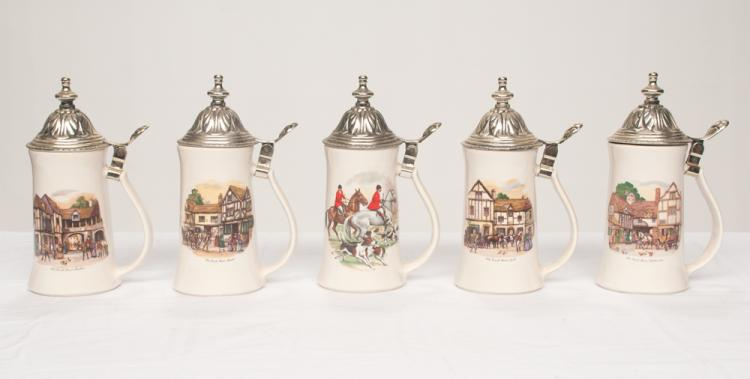 Group of five porcelain beer steins decorated with English scenes and having dome top silver plated lids, 9
