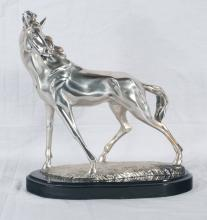 Silver sculpture of a horse (marked .800) mounted on an oval black base, 12.5