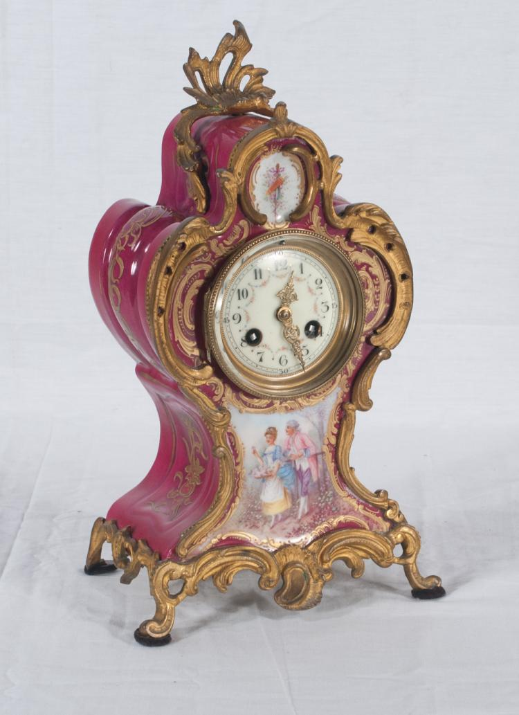 French bronze mounted porcelain mantle clock with porcelain panel at the base with garden scene and figures of a man and lady, c.1900