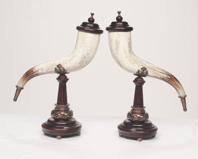 Pair of simulated horns with brass and silver mounts on a wooden stand with fluted columns and round base