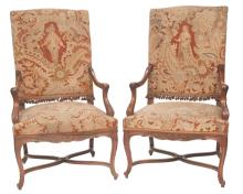 Pair of Louis XV style walnut fauteuils with leaf and scroll carved arms, caved aprons on carved cabriole legs with cross stretcher, covered in needlepoint tapestry, c.1900, 27