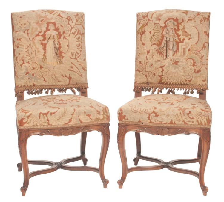 Pair of Louis XV walnut side chairs with needlepoint upholstery backs and seats, carved aprons and carved cabriole legs with carved stretchers, c.1900, 20