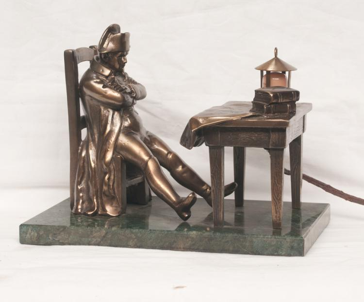Brass sculpture of Napoleon seated at his desk (the round desk light is illuminated), mounted on a marble base, 10.5