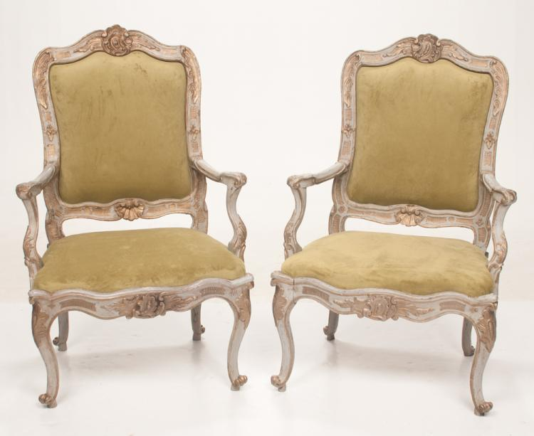 Pair of Louis XV carved, painted and gold gilt fauteuils with leaf and shell carved backs, serpentine front seat rails and on carved cabriole legs, 27
