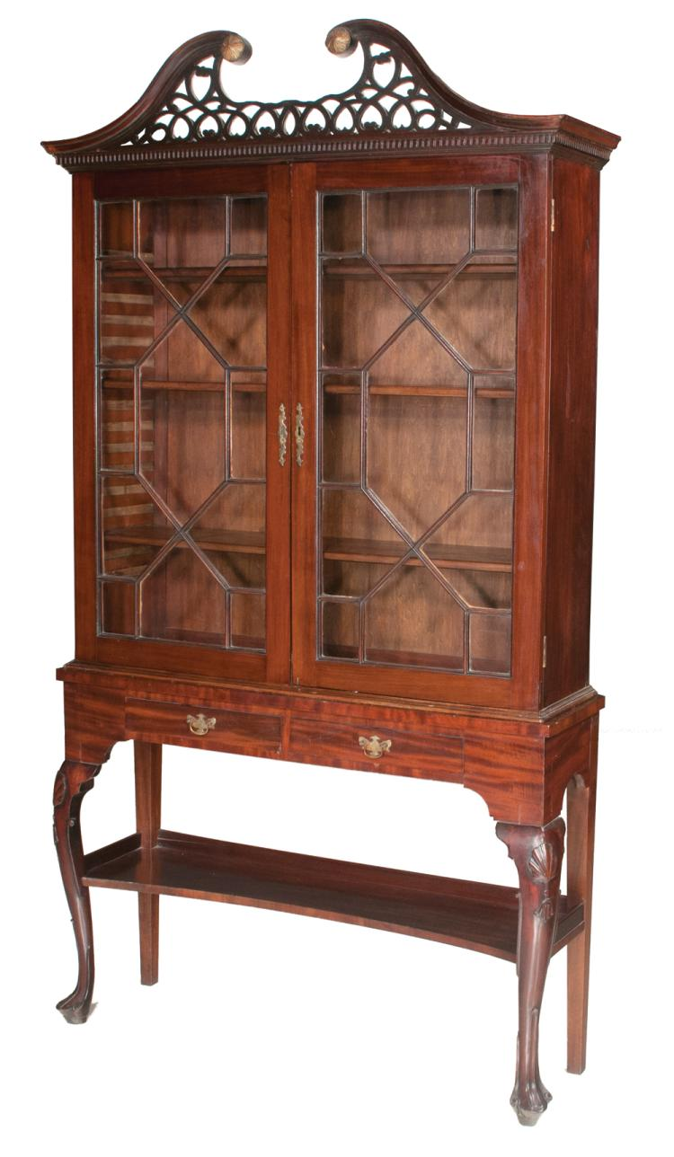 Queen Anne style mahogany cabinet with pierced broken arch pediment, mullion glass doors, base has two drawers and on cabriole legs with shell carved knees and scroll carved pad feet, c.1860, 42.5