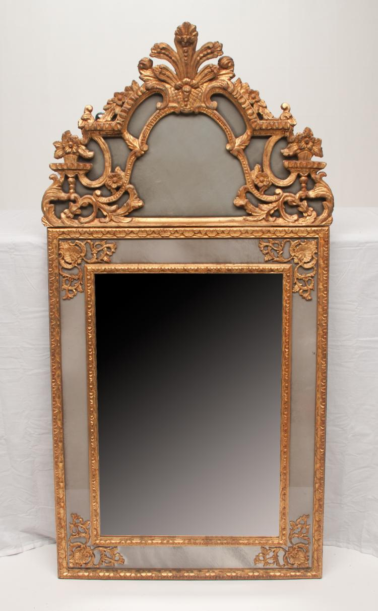 Gold gilt hand carved Venetian mirror with floral and plume pediment and scroll and shell design in the corners, 60