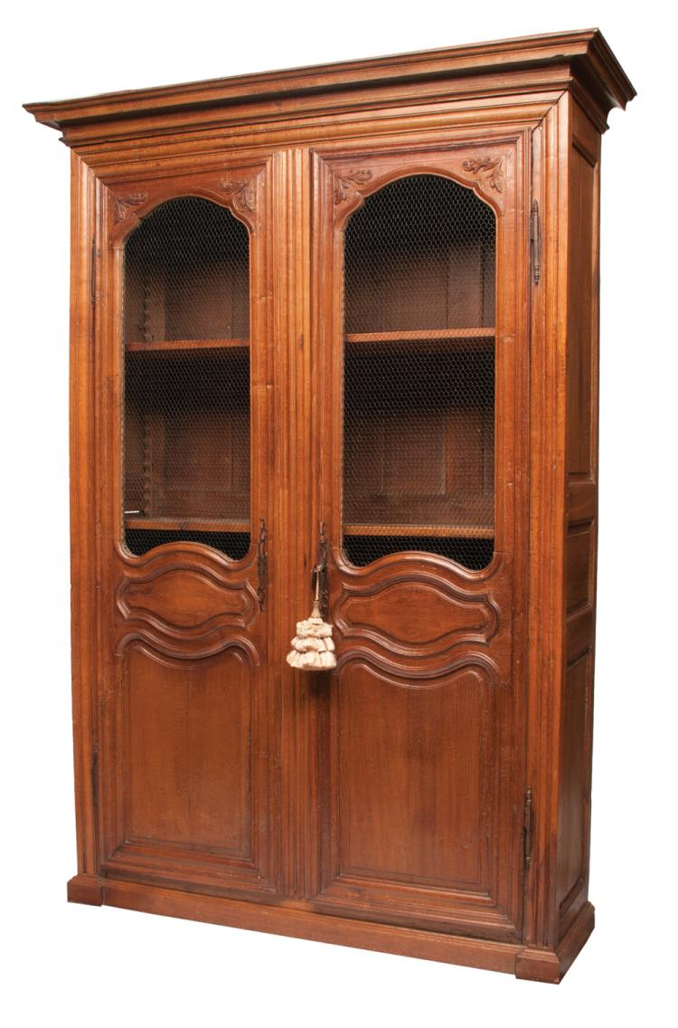 Country French elm and oak bibliotech cabinet with shaped crown moulding, double doors with grill work in the tops above raised panels in the base, c.1840, 60