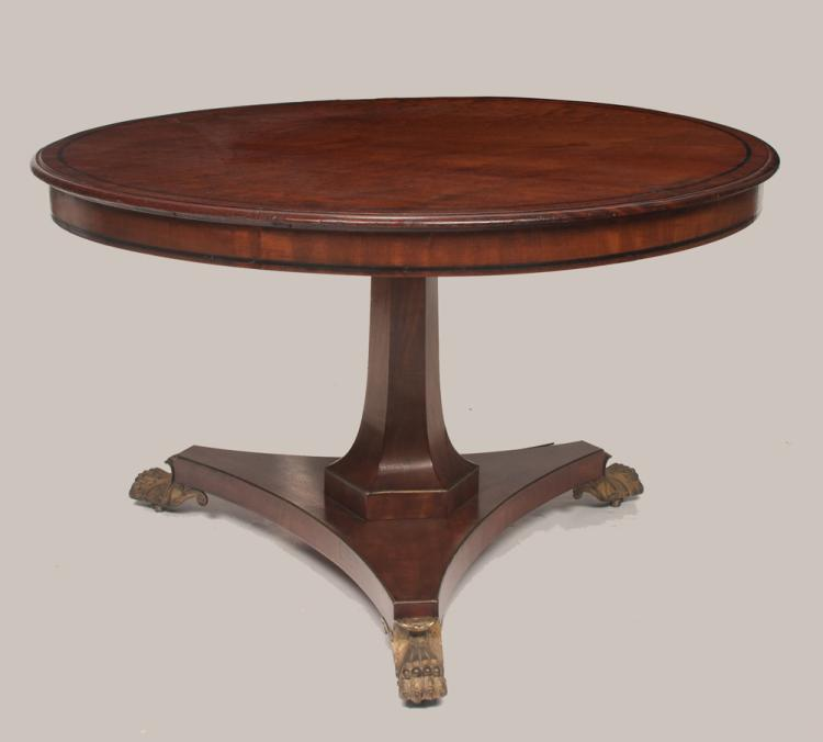 English Regency circular walnut library table on a hexagonal pedestal set on a triangular shaped platform with gold gilt claw feet, 48