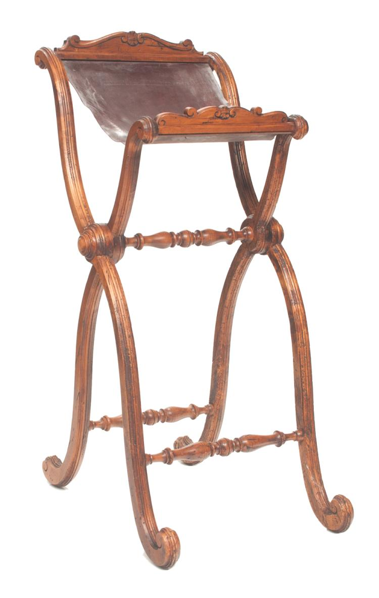 Walnut reading stand with scroll carving at the top, on scroll carved legs with stretchers, 22