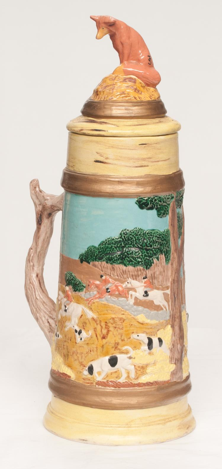 Glazed beer stein with fox hunters on horseback with hunting dogs in relief with dome lid with fox mount, 18