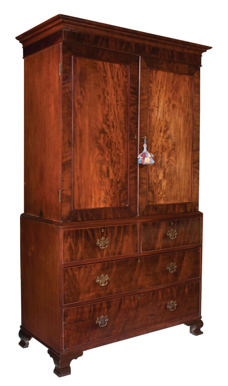 Chippendale mahogany linen press with panel doors, base has two small drawers over two full graduated drawers and ogee bracket feet, c.1830, 52.5