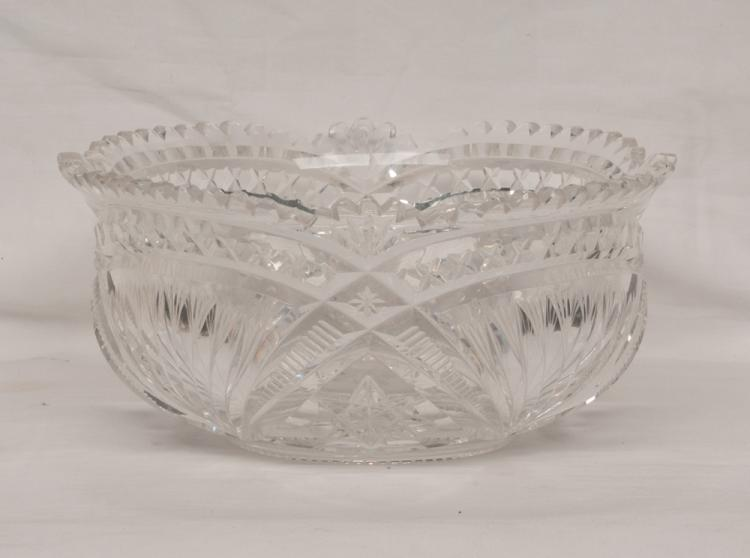 Fancy cut glass bowl with scalloped top and star burst cut design, 9.5