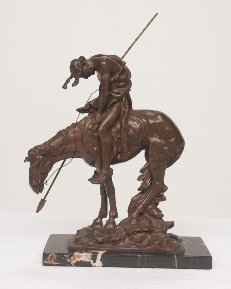 Bronze sculpture of Indian on horseback titled End of the Trail on marble base, 10.5
