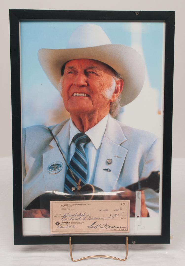 Framed photograph of Bill Monroe along with a check signed by Bill Monroe, overall 21.5