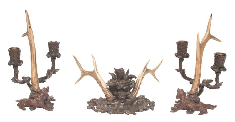 Pair of bronze two arm candelabra with center antler decoration and figures of hunting dogs at the base, 6