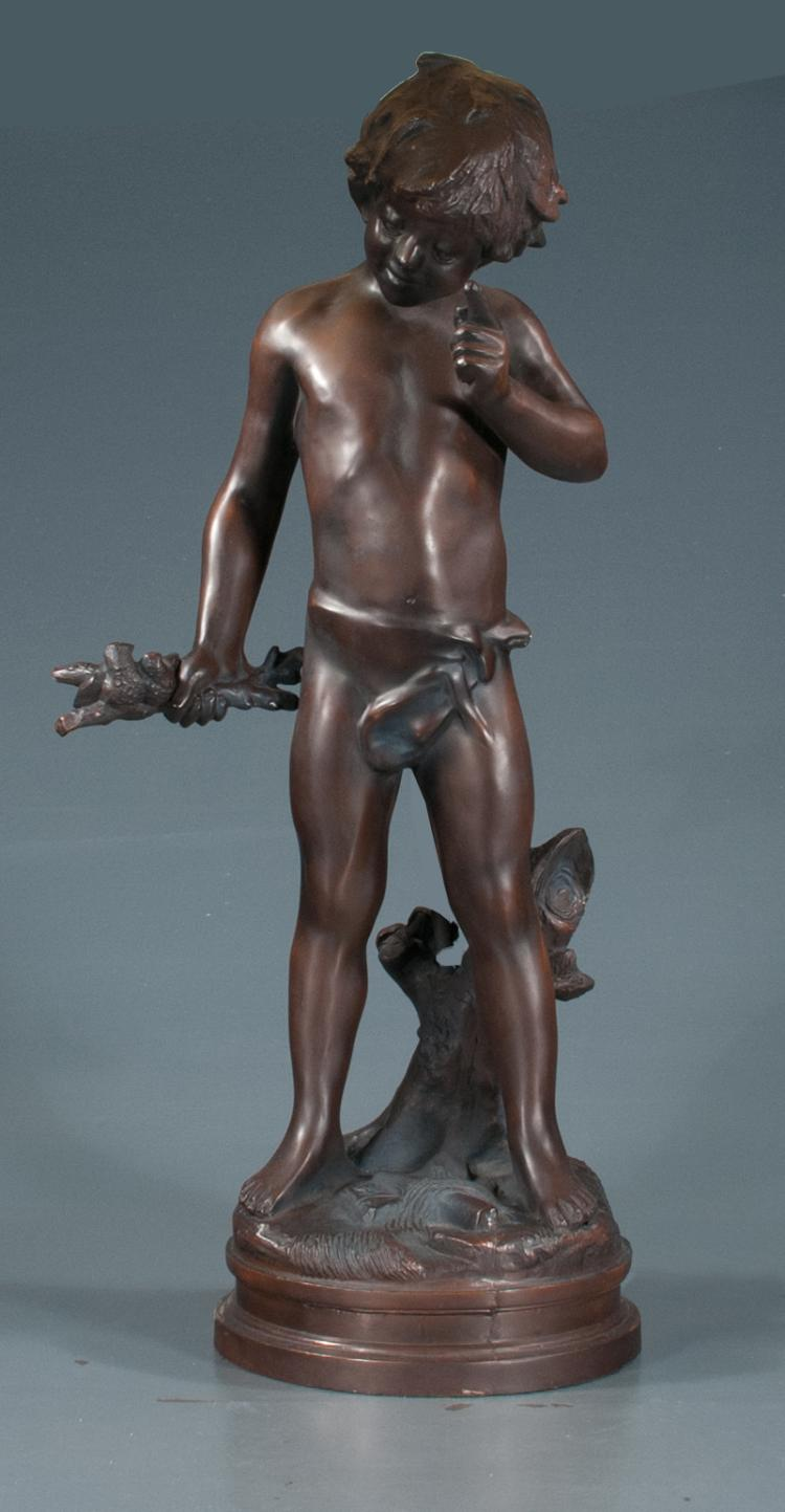 Spelter figure of a young boy holding a limb with two birds perched on it, 29
