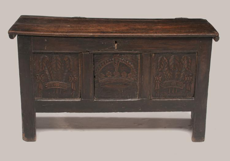 Jacobean oak coffer with three carved panels in the front, with crown, ribbon and palm carvings, 41
