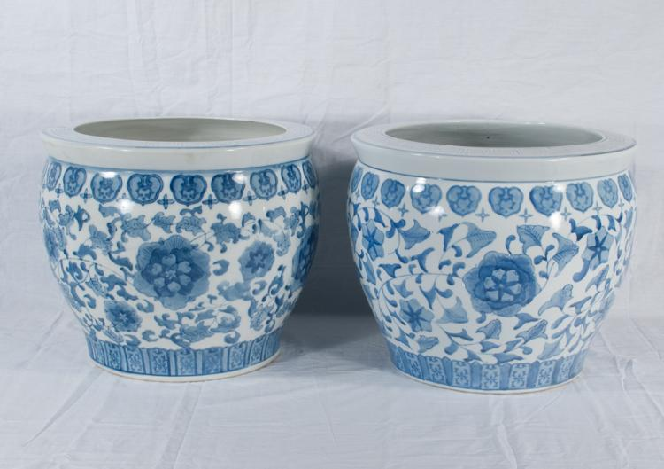 Pair of blue and white Chinese porcelain planters with leaf and floral decoration, 14.5