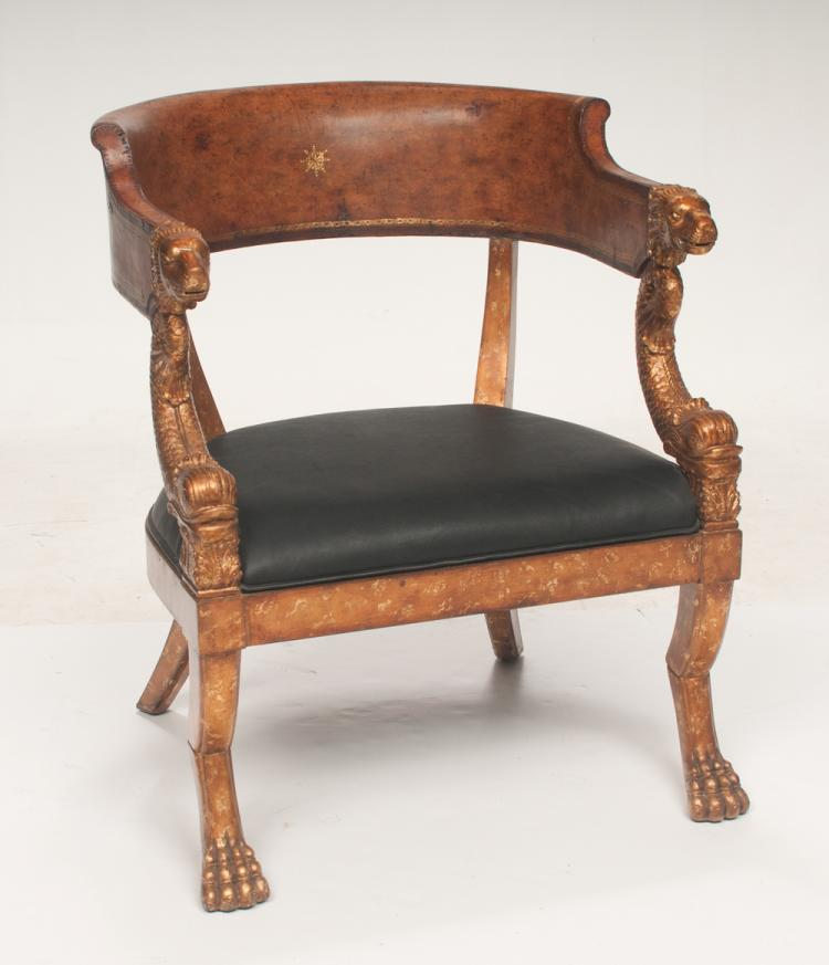 Empire style barrel back walnut armchair with carved and gold gilt lions heads and on claw feet, 27