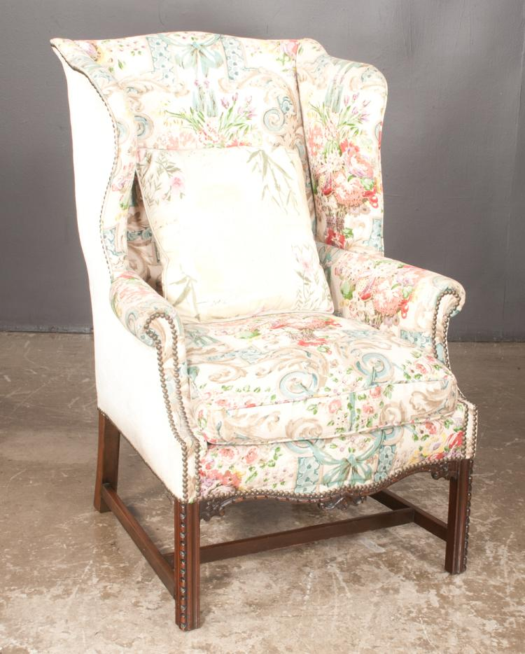 Chippendale style mahogany wing chair with serpentine front carved seat rail on straight moulded legs with stretcher, upholstered in a custom fabric, c.1900, 30
