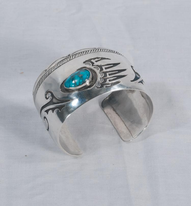 Wide sterling silver Indian bracelet set with a turquoise stone with a bear claw design