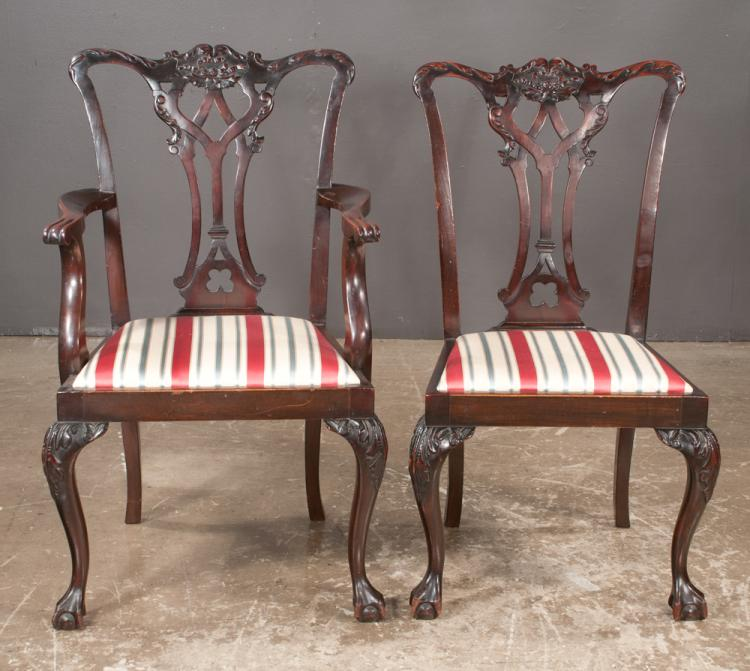 Set of eight Chippendale style mahogany dining chairs with leaf, scroll and ribbon carved backs on cabriole legs with carved knees and ball and claw feet