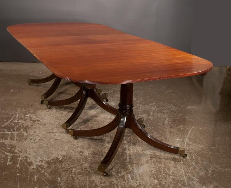 Sheraton style mahogany three pedestal dining table with finely grained top and fluting on the sides of the top, pedestals have turned columns and fluted splay legs, 48