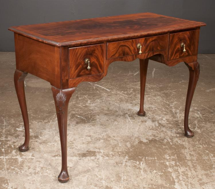 Queen Anne style mahogany writing table with cross banded top, three drawers and on cabriole legs with pad feet, 42