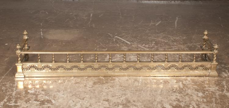 English brass fire fender with barley twist half columns above pierced shaped base, 55