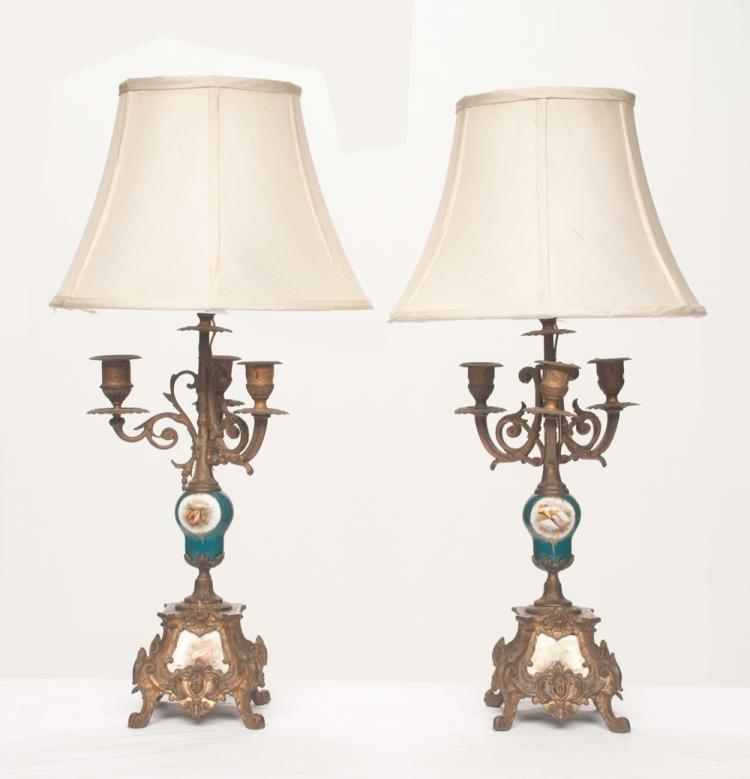 Pair of French three branch spelter candelabra with porcelain column and porcelain plaque in the base, 22
