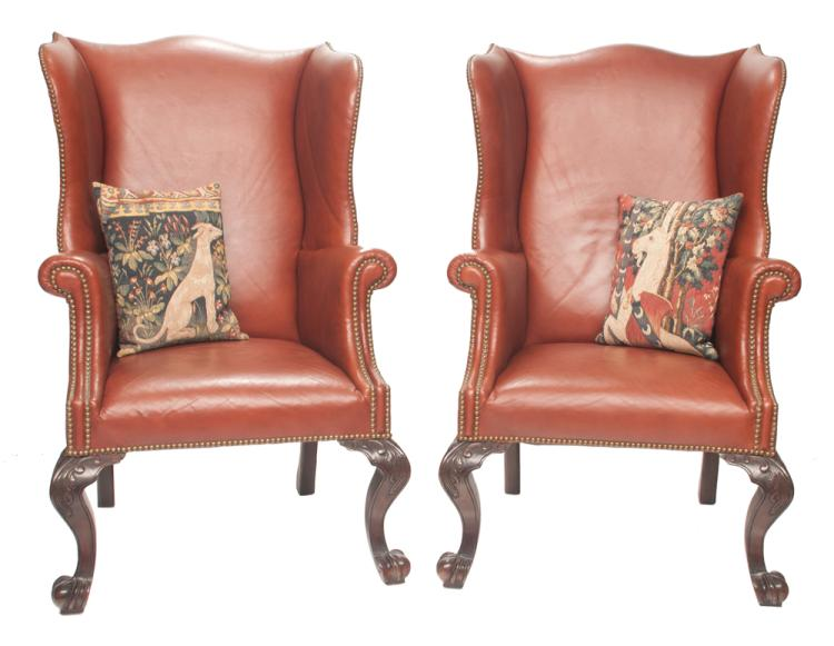 Pair of Chippendale style mahogany wing chairs covered in leather with brass nail trim with roll over arms on cabriole legs with scroll feet, 31