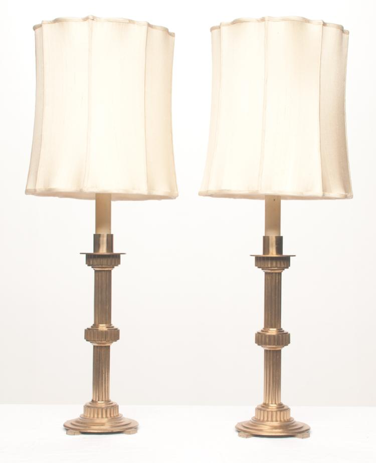 Pair of gilt bronze candlestick lamps with fluted column and circular base, 32