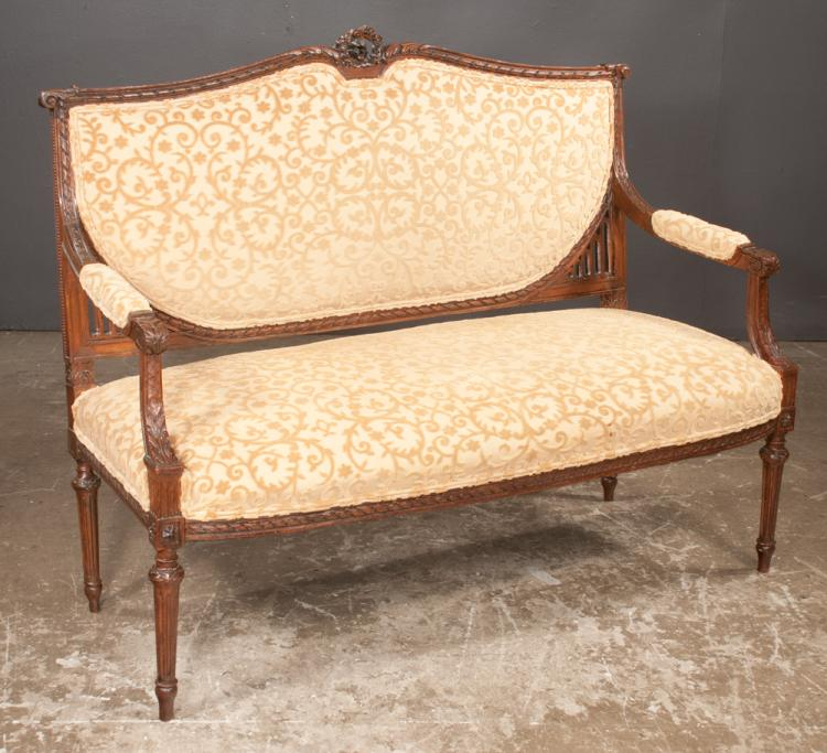 Louis XVI style walnut canap_ with arch shape and carved back rail, carved arms and on tapered fluted legs, with custom upholstery, c.1900, 52