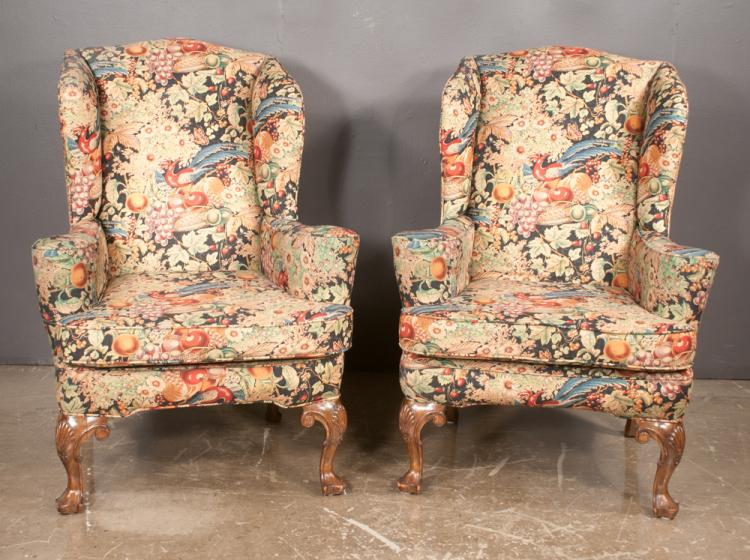 Pair of Queen Anne style wing chairs with scroll shape arms on cabriole legs with shell carved knees and shaped pad feet, 33