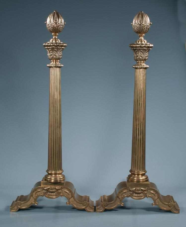 Pair of brass andirons with acorn finials, fluted columns and shell and scroll design bases, 33.5