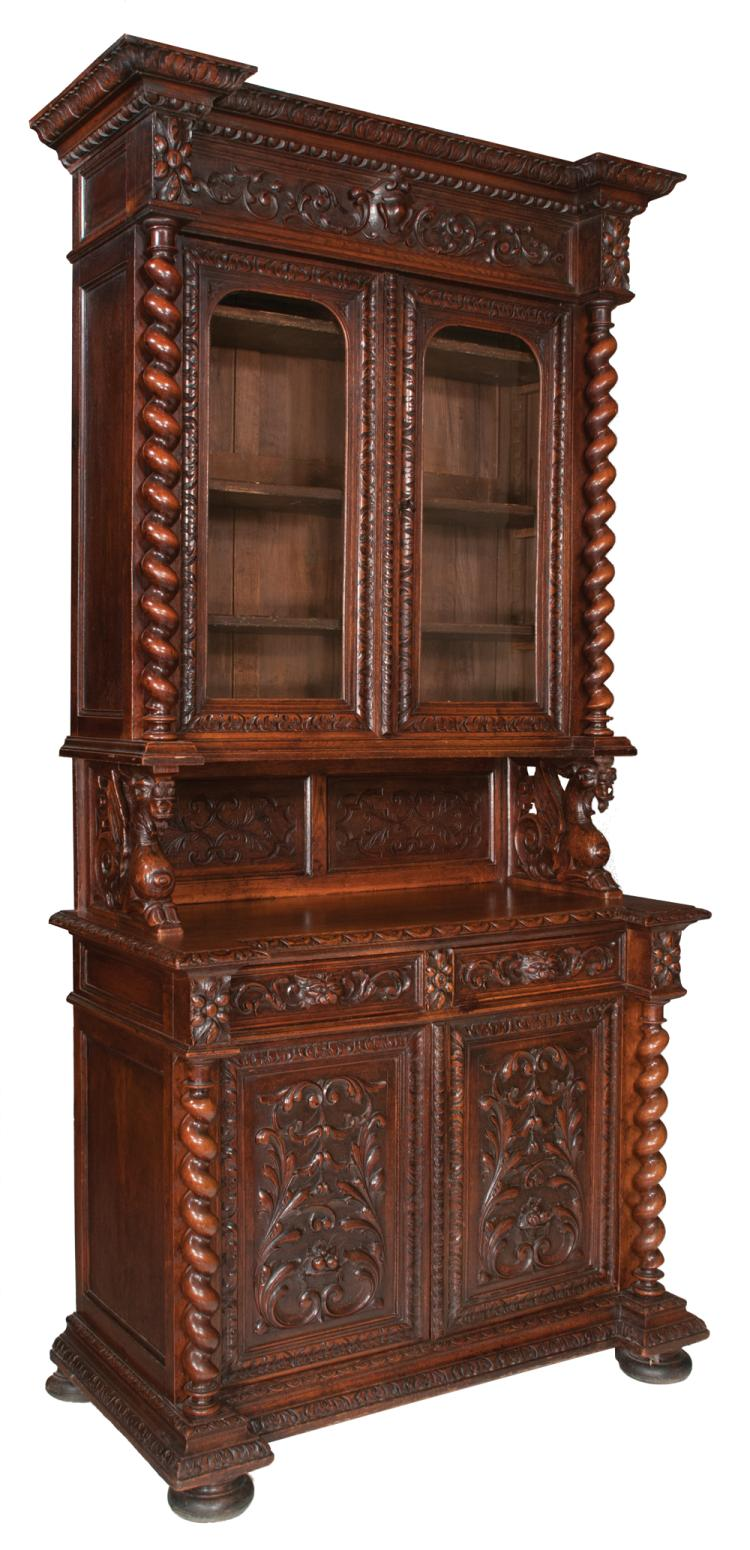 Two part Country French carved oak hunting lodge cabinet with scroll carved cornice, double panel glass doors, barley twist columns to top, base has two carved drawers over two carved cupboard doors and on bun feet, c.1830, 46