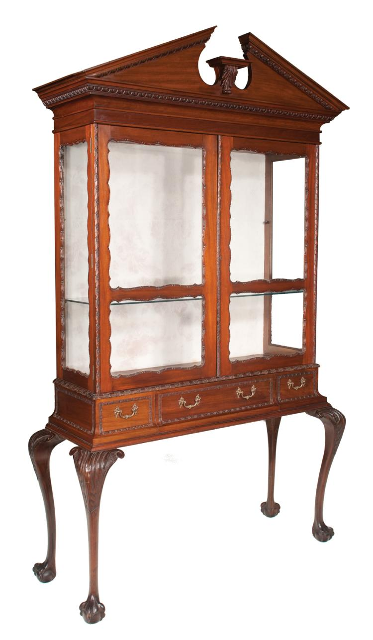 Chippendale style mahogany display cabinet with broken pediment cornice, top has double glass panel doors, base has one center drawer on cabriole legs with acanthus carved knees and ball and claw feet, c.1900, 51