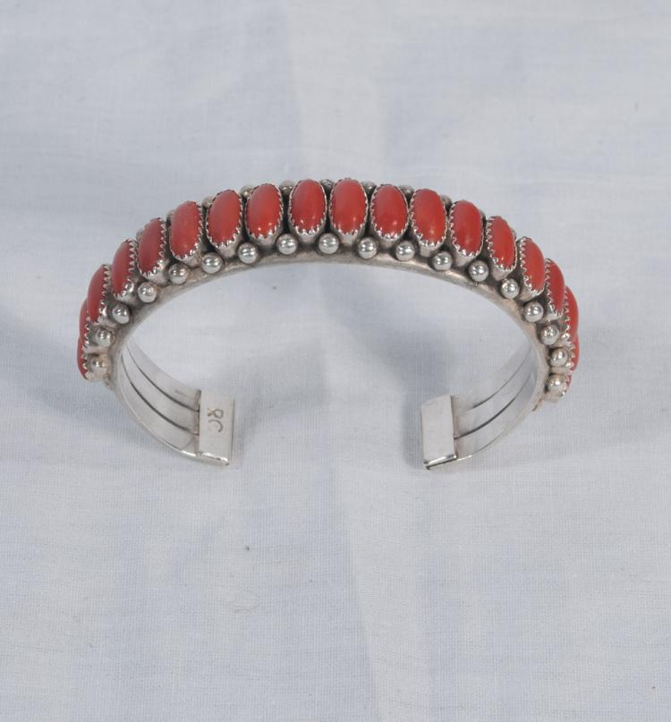 Sterling silver Indian bracelet set with small oval coral stones inscribed R.C.