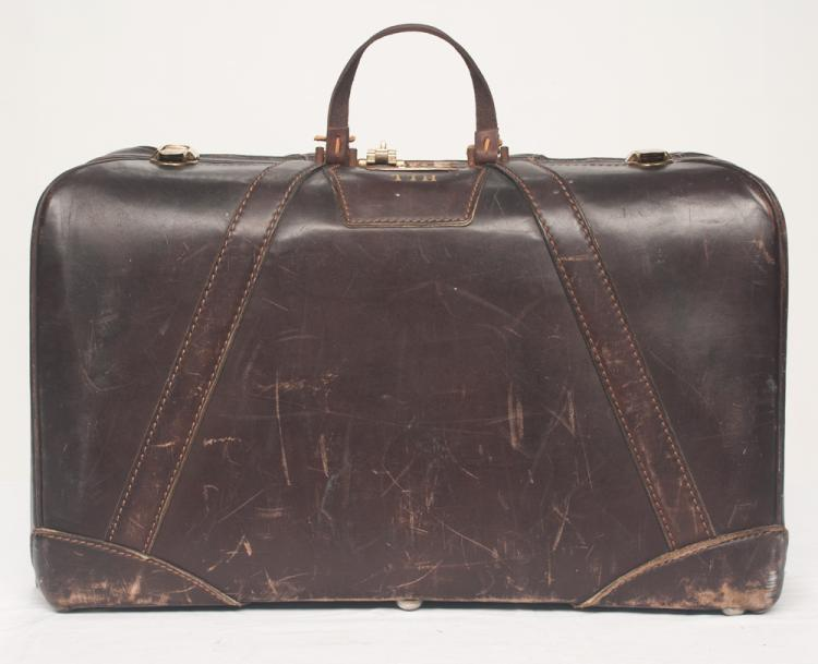 Tom T. Hall's leather Million Mile carry on bag, 21