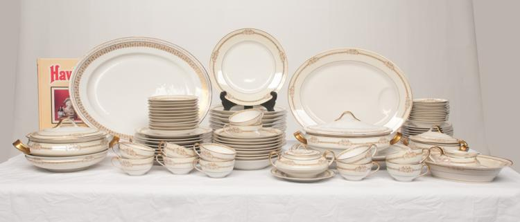 Set of 68 pieces of Theodore Haviland Limoges china with gold gilt and floral decoration, along with a Haviland china reference book