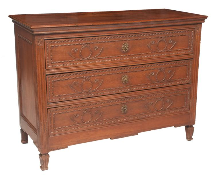 Louis XVI oak three drawer commode with garland and bow carving on the drawer fronts on square tapered legs, c.1880, 50